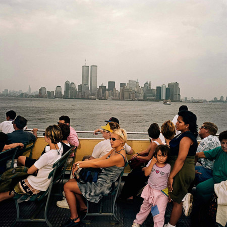 Tourists On Ferry To Statue Of Liberty Island Ny