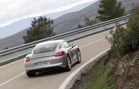 Porsche Cayman S trasera curva