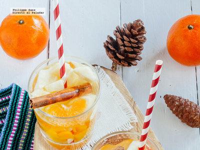 Ponche frío de vino blanco y mandarina. Receta de bebida para Navidad