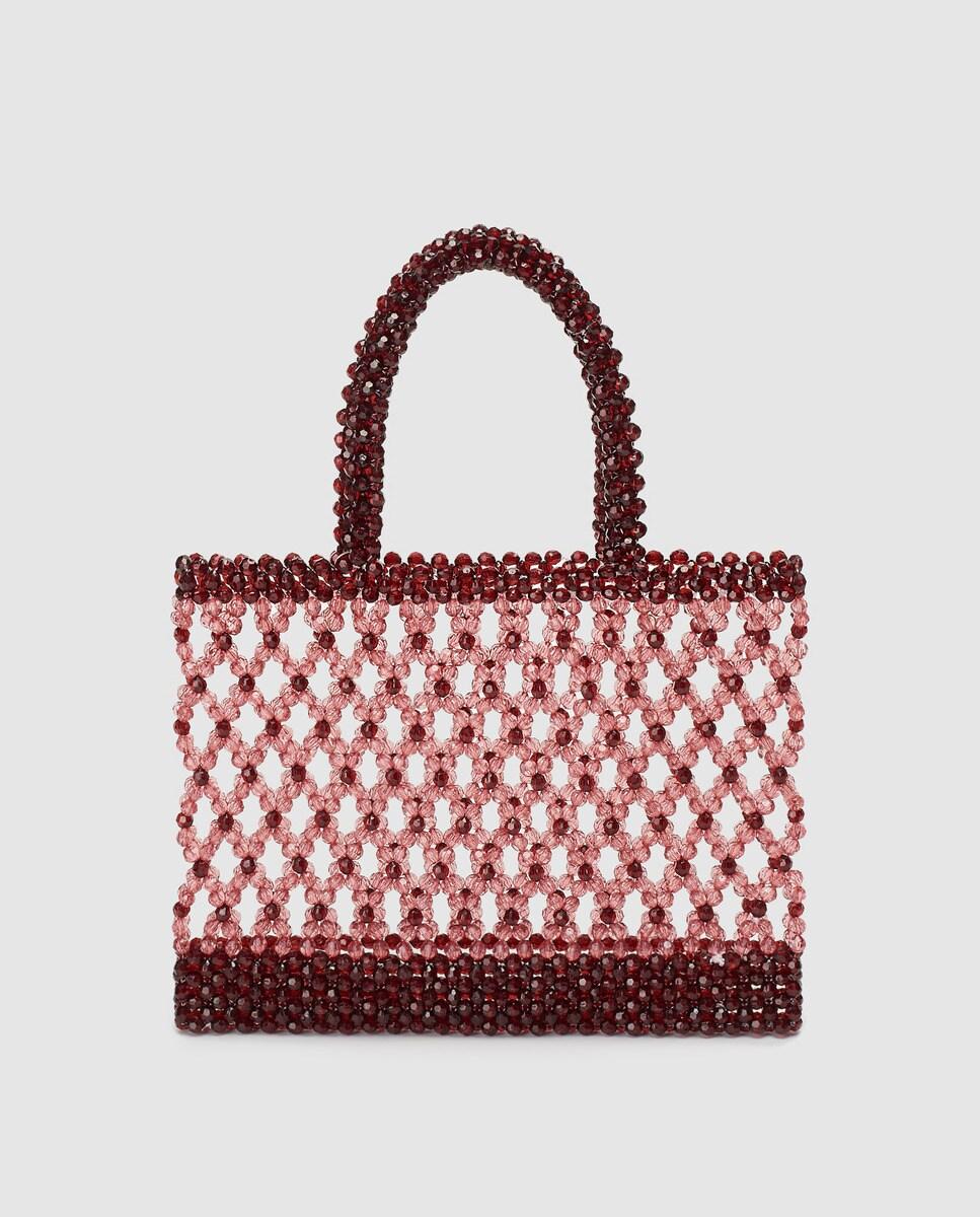Shopping pequeño El Corte Inglés en coral con entramado de abalorios a tono