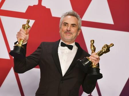 Cuarón con sus Oscars