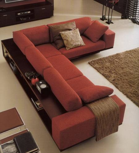 Un sof con espacio de almacenaje alrededor for Sofa con almacenaje