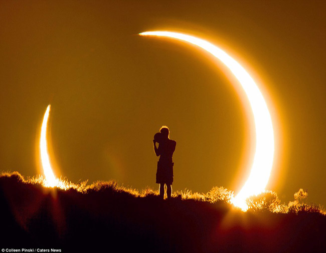 Boy surrounded by solar eclipse, by Colleen Pinski