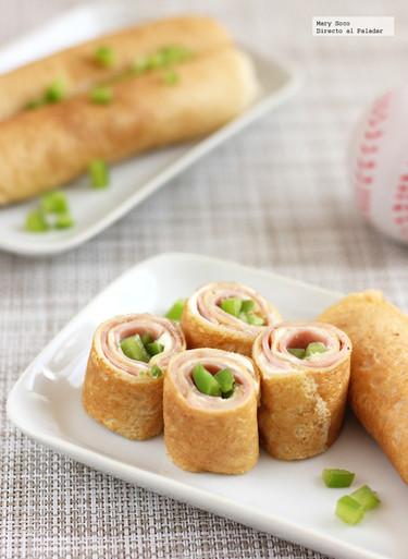 Rollos de crêpes con jamón y queso. Receta para niños
