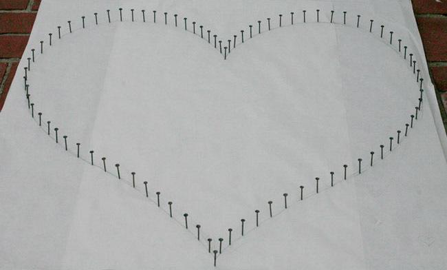 Corazón con clavos