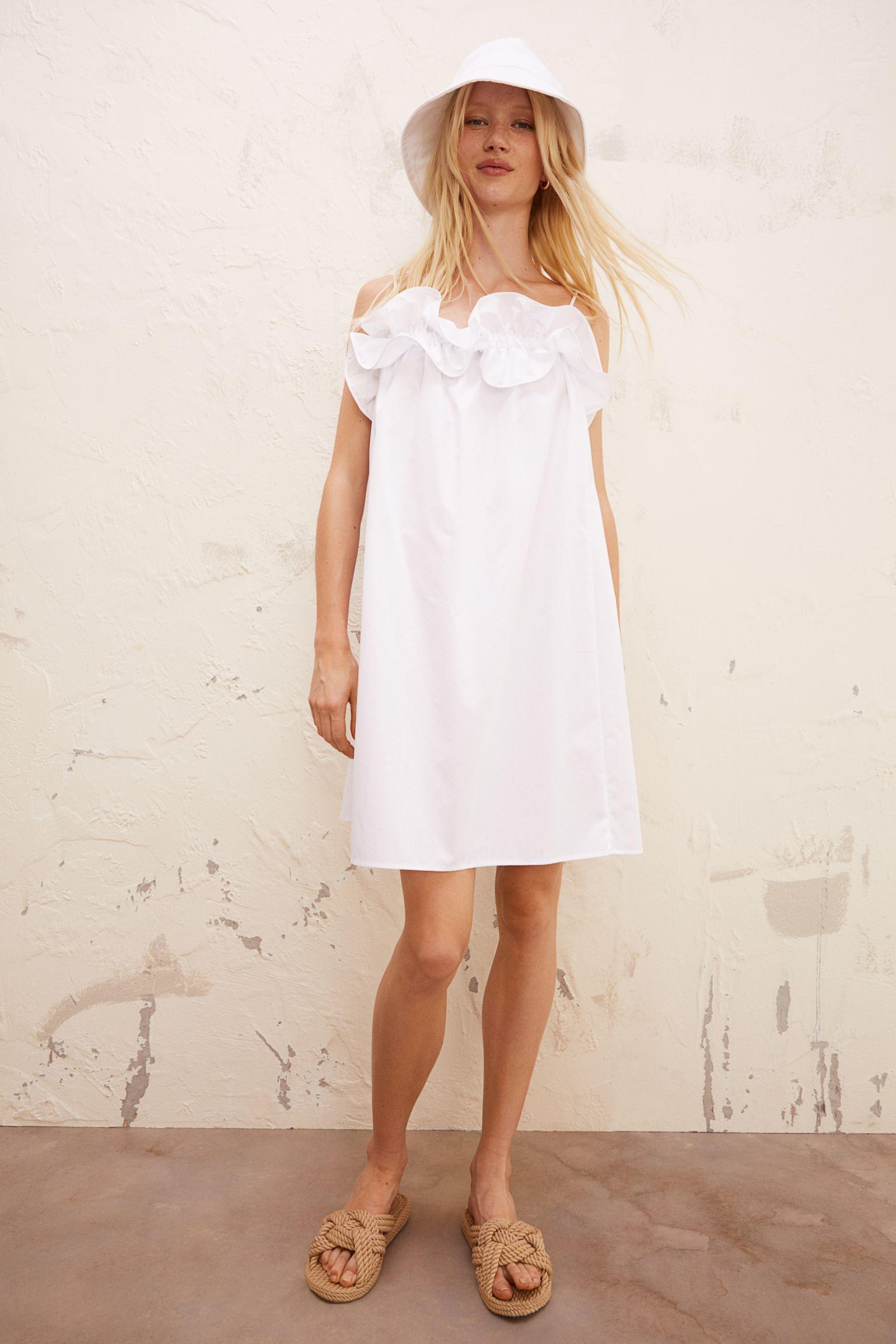 Vestido corto en tejido de algodón con tirantes espagueti ajustables.