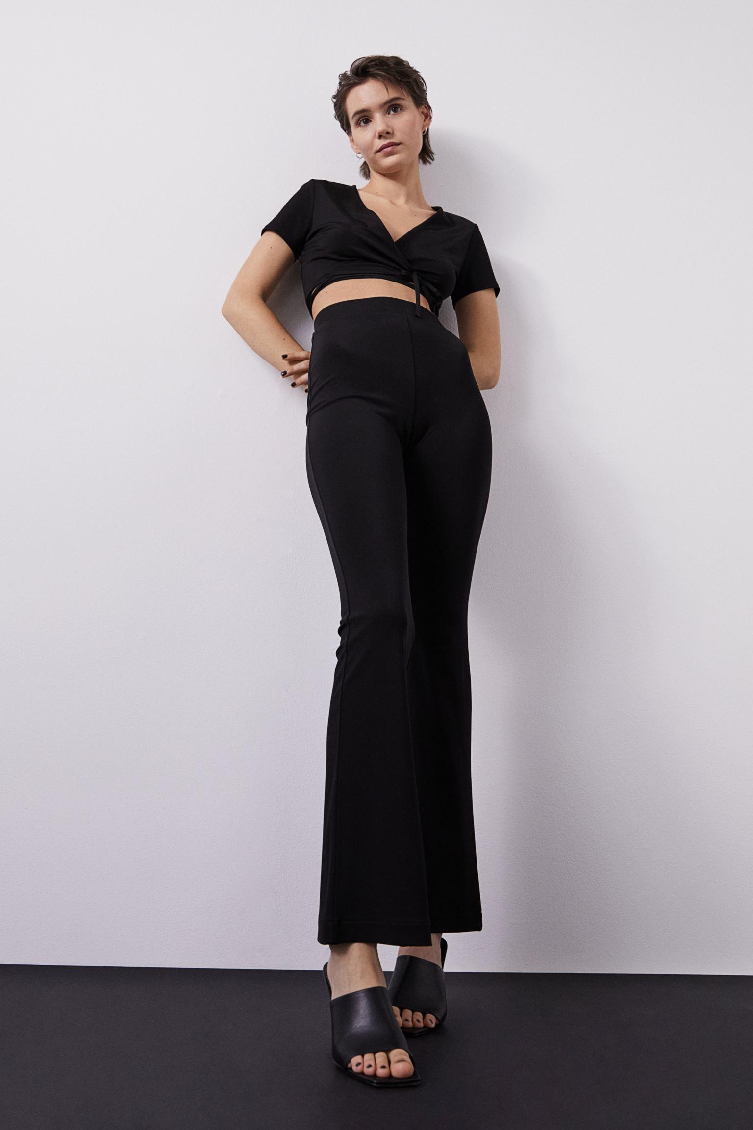 Pantalones de campana con diseño elástico de estilo legging