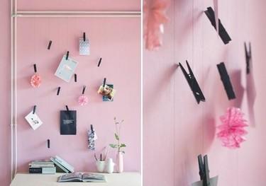 Hilos y pinzas pintadas para crear una sencilla pero bonita pared de recuerdos