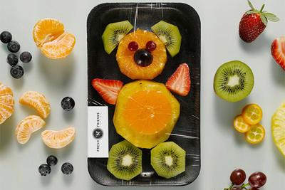 Figuras de fruta para promocionar la agricultura orgánica
