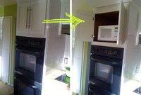 Esconde el microondas en un armario de la cocina