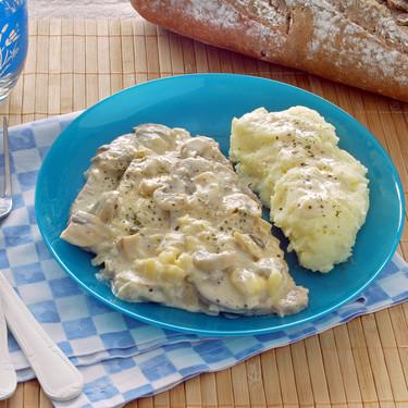 Receta de filetes de lomo de cerdo en salsa de champiñones con queso brie