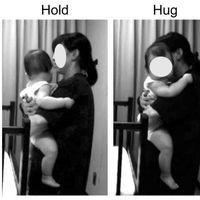 Los bebés se tranquilizan más si les abraza sus padres antes que un extraño