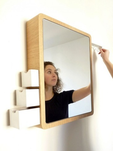Foto de Espejo con discretos compartimentos para almacenaje (1/5)