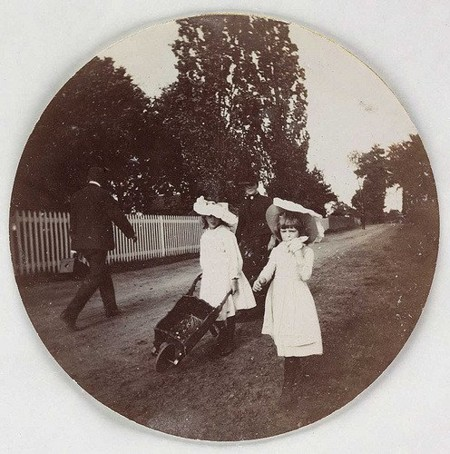 Children Walking With A Wheelbarrow About 1890