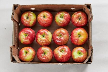 Manzanas en la Caja