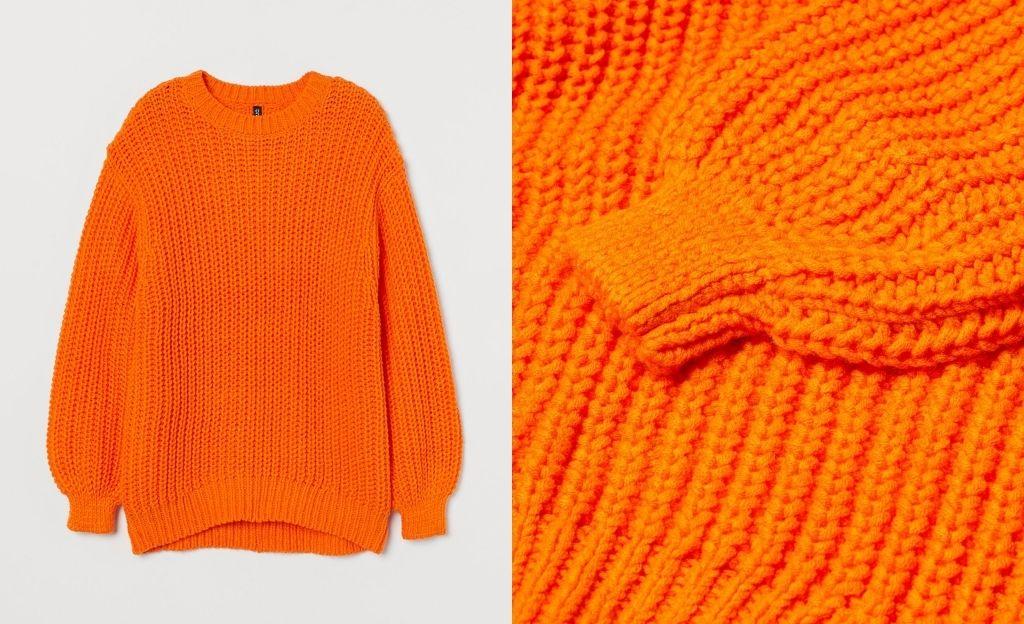 Jersey oversize en punto grueso suave con hombros marcadamente caídos y mangas amplias ceñidas en los puños.