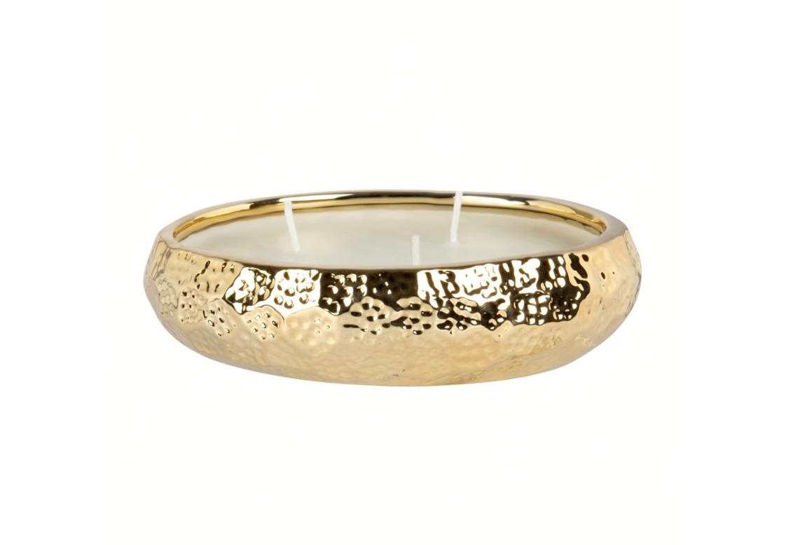 Vela perfumada en tarro de cerámica dorada