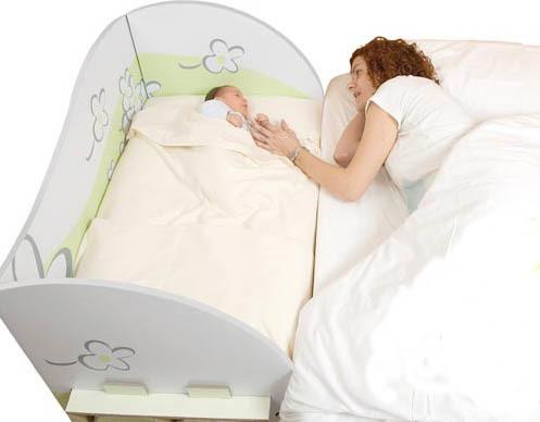 cuna de cartn para adosar a la cama de los padres