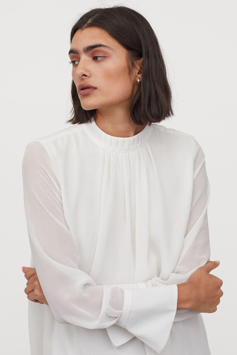 Blusa con pliegues de manga larga