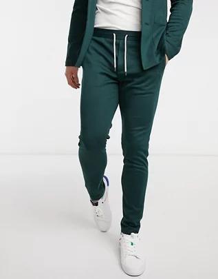 Pantalones de sastre superpitillo color verde botella de punto de ASOS DESIGN