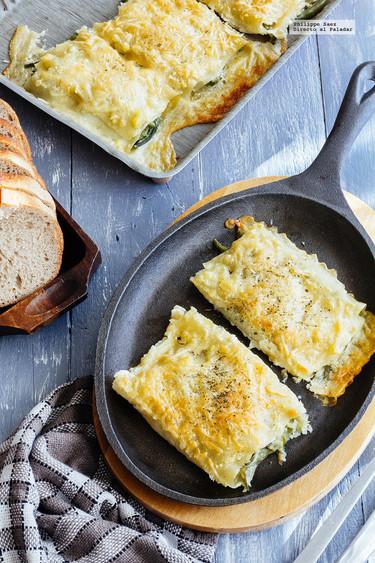 Rollos de lasaña rellenos de ejotes y queso. Receta vegetariana