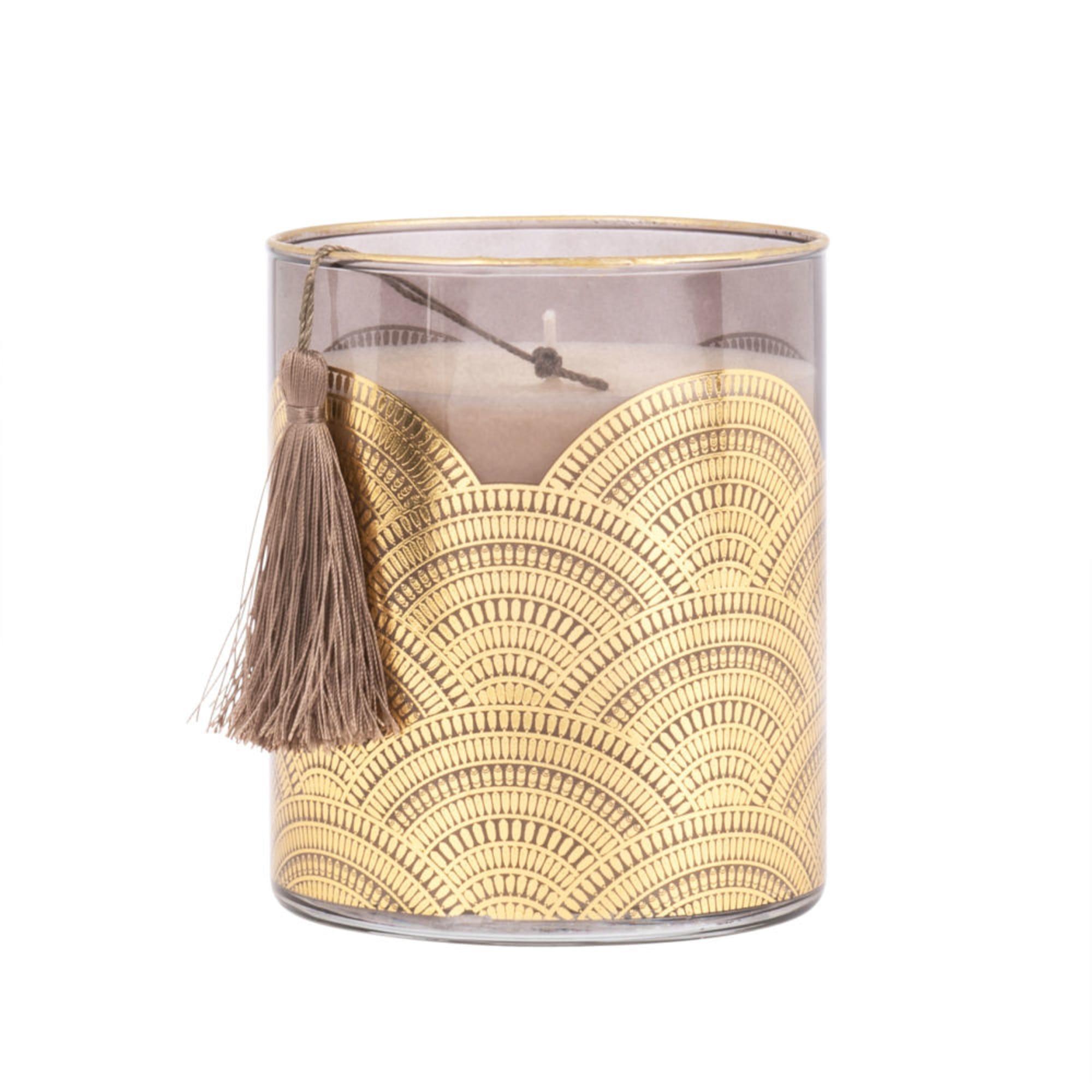Vela perfumada en tarro de cristal tintado con motivos decorativos dorados
