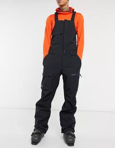Mono de esquí negro con diseño utilitario de Quiksilver
