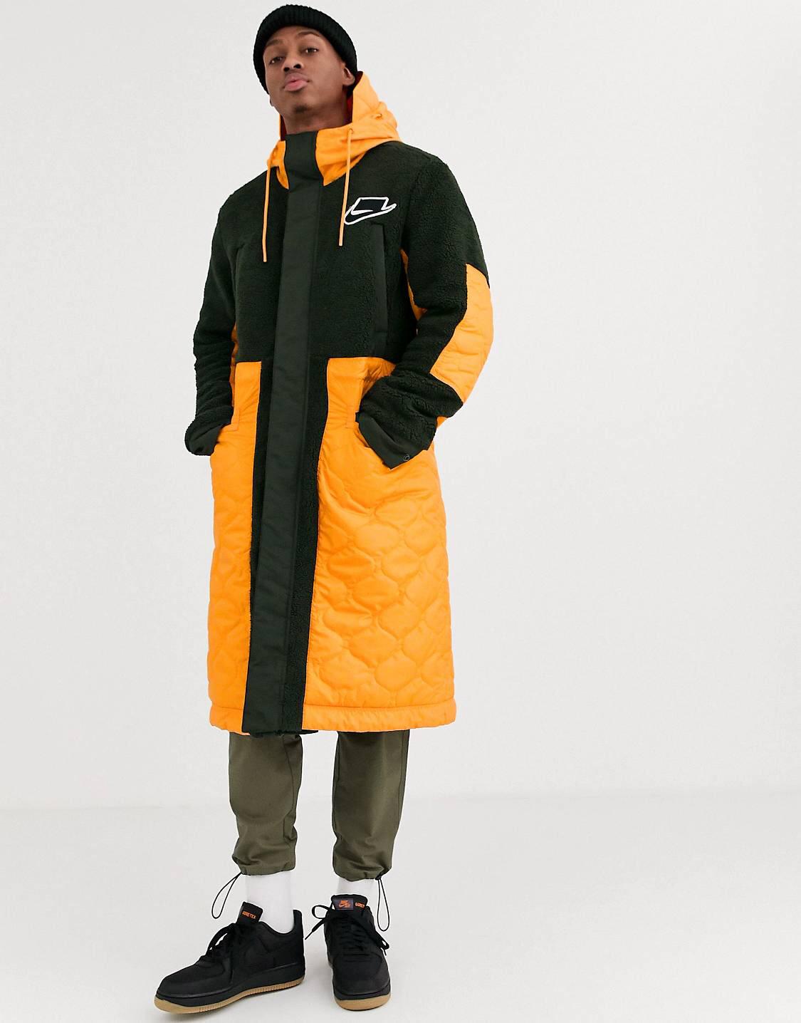 Parka de polar acolchada en naranja/caqui Air de Nike