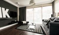 Un apartamento minimalista en colores oscuros