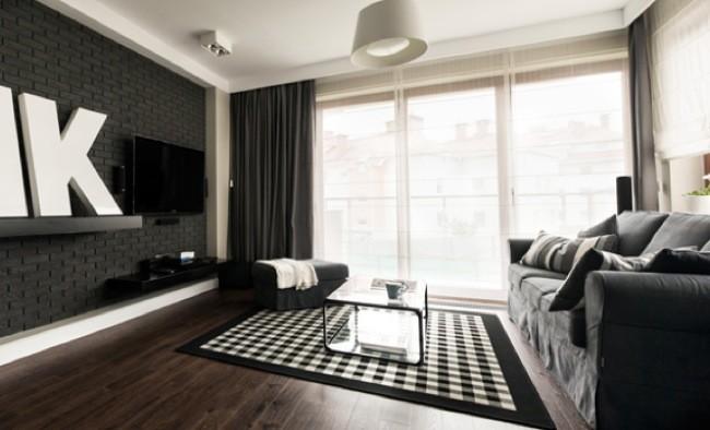 Un apartamento minimalista en colores oscuros for Decoracion apartamento pequeno estilo minimalista