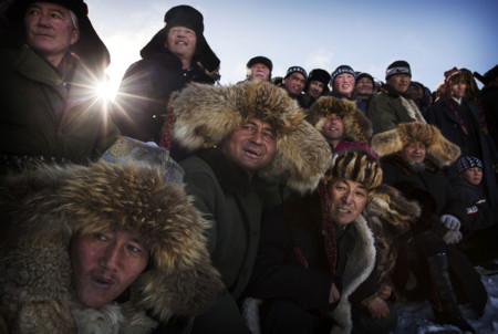 Spectators React As They Watch A Chinese Kazakh Eagle Hunter Not Seen Release His Bird During A Local Competition In The Mountains Of Qinghe County Xinjiang Northwestern China Kevin Frayersony World Photography Awards 2016