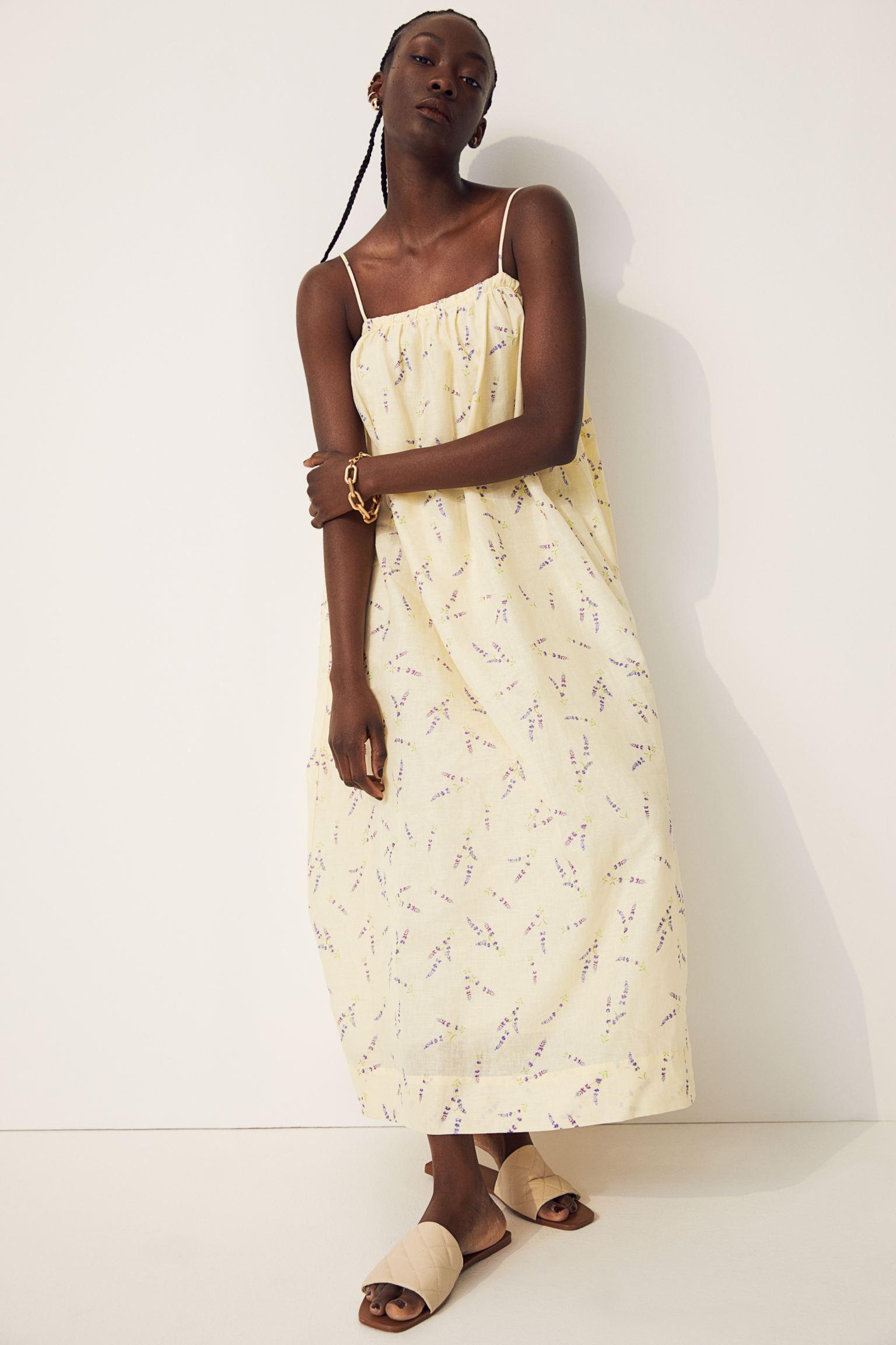 Vestido midi en tejido de lino vaporoso