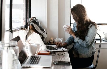 Woman In Gray Jacket Sitting Beside Desk 2682452