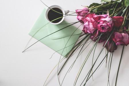 Bouquet Of Pink Flowers Beside White Ceramic Mug 1410225