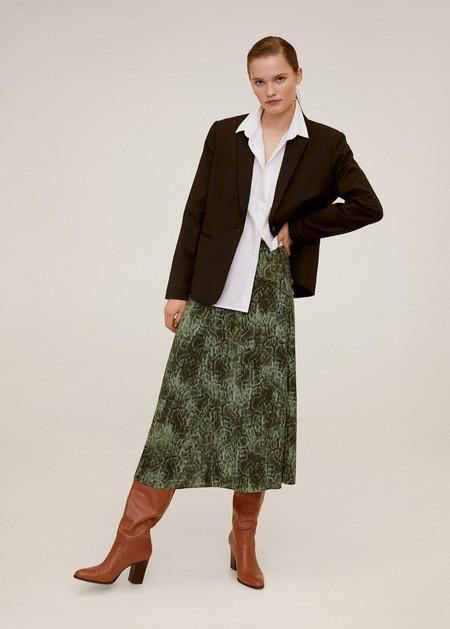 https://shop.mango.com/es/mujer/faldas-midi/falda-midi-lunares_67075972.html