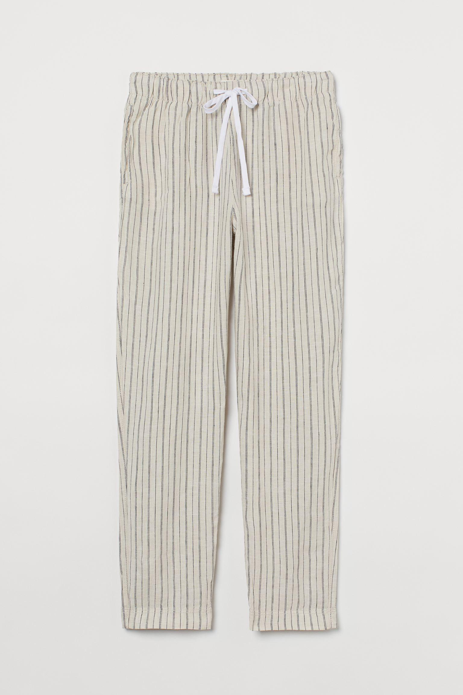 Joggers tobilleros en lino vaporoso. Modelo de corte relajado con cintura elástica de talle alto, cordón de ajuste y bolsillos al bies. Corte relajado.