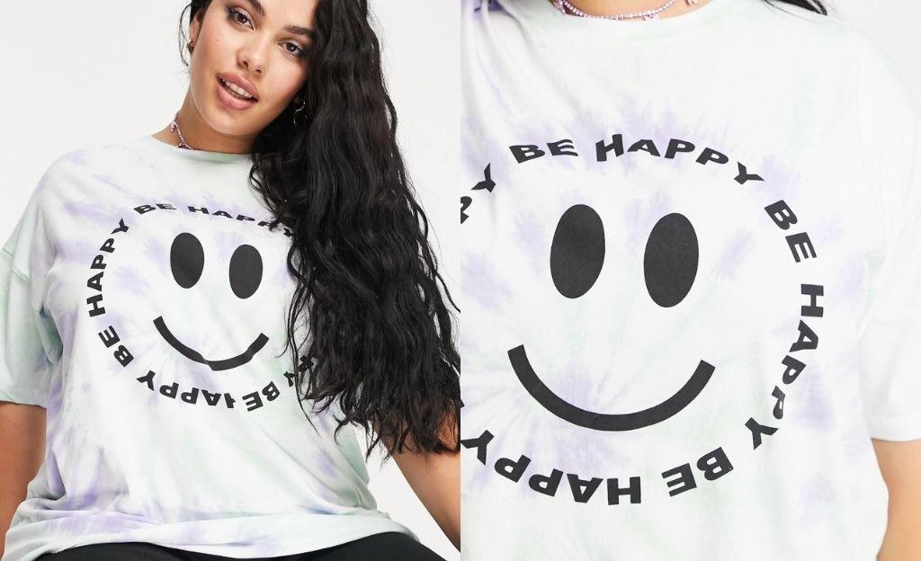 Camiseta extragrande con diseño tie dye en espiral y estampado Be Happy de ASOS DESIGN Curve