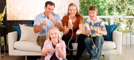 Family Playing Nintendo Wii And Wii U