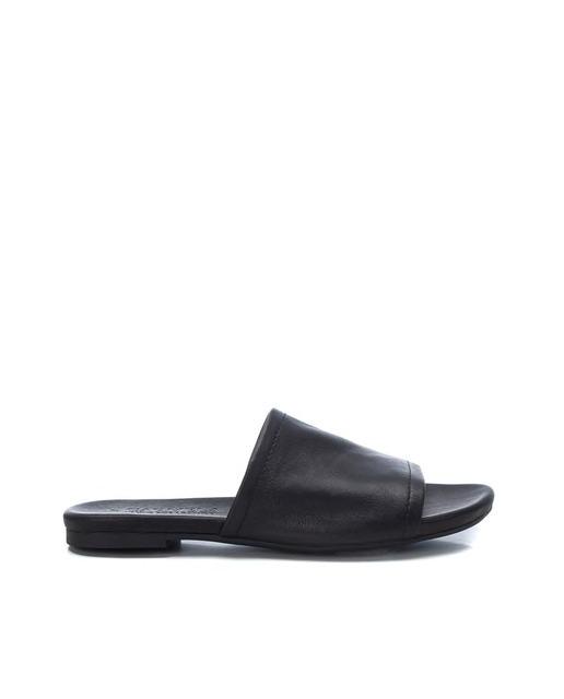 Sandalias planas de mujer Carmela de piel color negro y tacón plano
