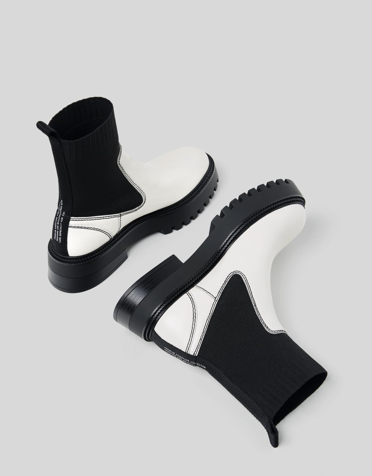 Botines en black&white con suela trekking y diseño calcetín de punto y piel
