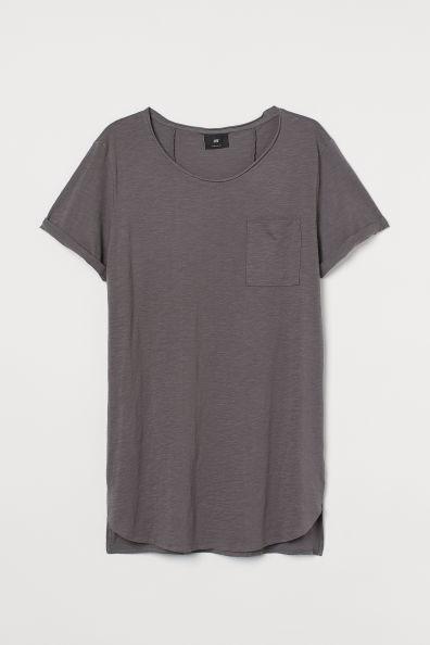 Camiseta larga loose fit gris