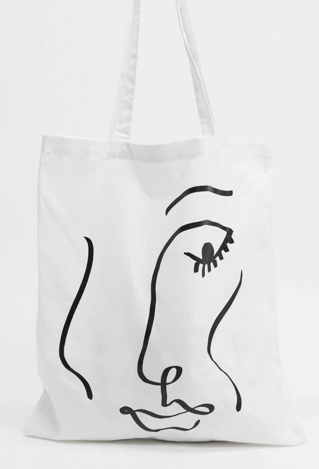 Bolso shopper de lona con estampado de cara superpuesto de ASOS DESIGN