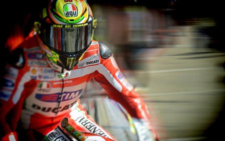 MotoGP Gran Bretaña 2012: con agua, Valentino Rossi, sin agua, Casey Stoner