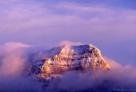 Un fondo de pantalla de Snow Leopard es de un fotógrafo español