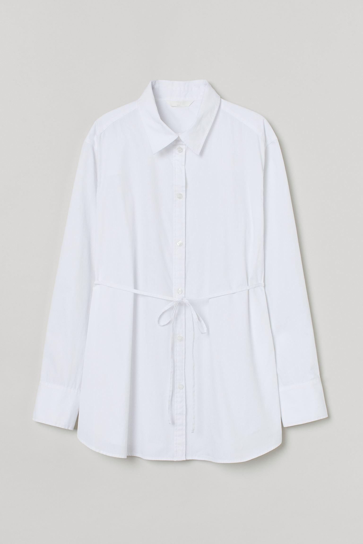 Camisa blanca de algodón con lazo en la cintura