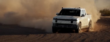Bestial!  The Rivian R1T electric pick-up demonstrates its off-road skills by skidding and 'climbing' on its particular Dakar