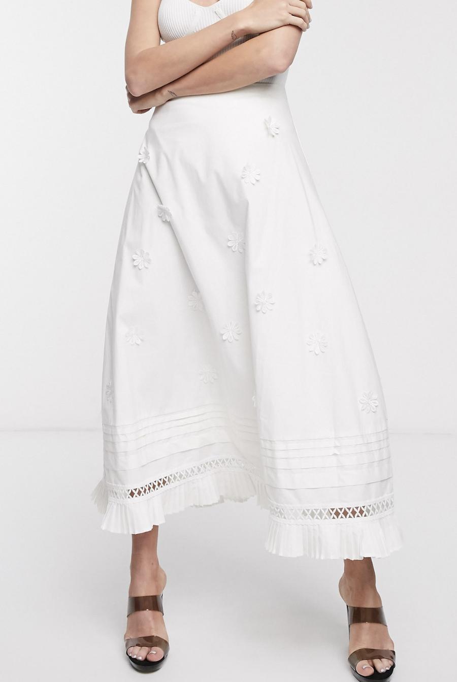 Falda midi con bajo plisado y aplicación floral de algodón de Lost Ink