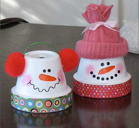 Muñecos de nieve con macetas