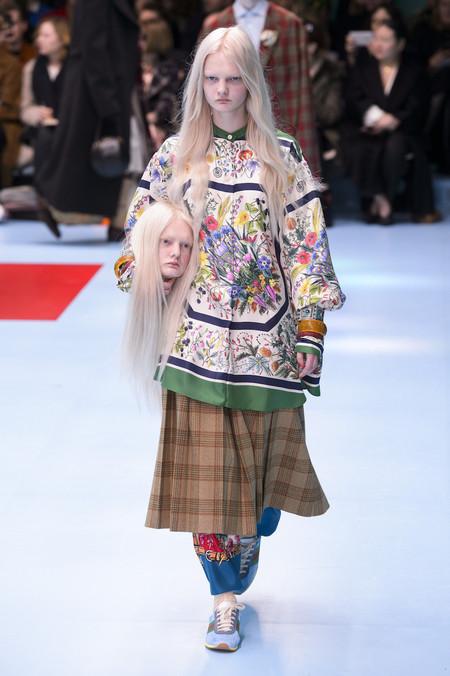Cabezas Armani Gucci