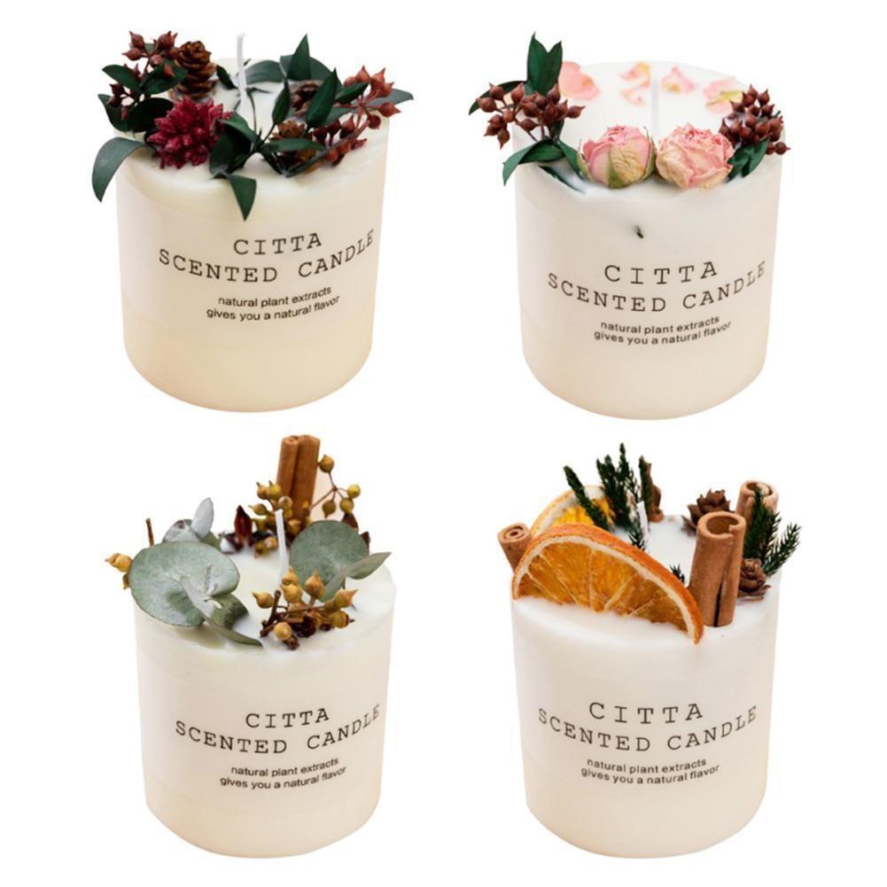 Vela decorada con flores y frutas de diseño